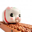 Piggy bank and abacus - Stock Photo