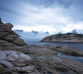 Storm sky with the rocks, low saturation — Stock Photo