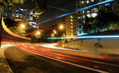 Car light in city at night — Stock Photo