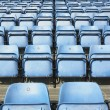 Empty blue stadium seats — Stock Photo