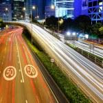 Traffic light stream in city at night — Stock Photo
