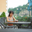 Girl using pmp in cafe — Stock Photo