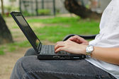Work outdoor with laptop computer — Stock Photo