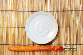 Plate and chopsticks — Foto de Stock