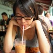 Girl drinking Hong Kong-style milk tein Dai pai dong — Stock Photo #3785275