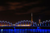Railway bridge at night in Riga — Stock Photo