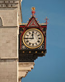 Clock on the royal courts of justice — Stock Photo