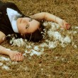 Young girl lying on the hay — Stock Photo