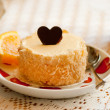 Love cheesecake with chocolate heart and — Stock Photo