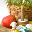 Easter eggs a candle and a lamb — Stock Photo