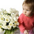 The child and white tulips — Stock Photo