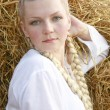 Stock Photo: Girl with plaits in white shirt