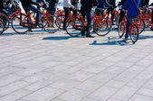 Standing bicyclists — Stock Photo