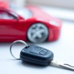 Car key near small remote red super car — Stock Photo #2720032