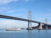 Hornblower Boat Travels Under Bay Bridge — Stock Photo