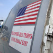 "Stock Photo: USFlag and ""we support troops"" stickers on side of p"
