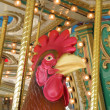 Rooster ON A CAROUSEL — Stock Photo