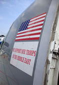 """USA Flag and """"we support the troops"""" stickers on the side of a p — Stock Photo"""