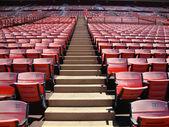 Rows of empty orange stadium seats going upward — Stock Photo