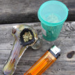 Jar of Medical Marajuana, Pipe and lighter sitting on a well use - Stock Photo