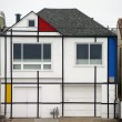ocean beach house painted in the style of famed artist piet mond — Stock Photo