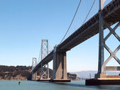 San Francisco side of Bay Bridge from ferry boat sailing underne — Stock Photo