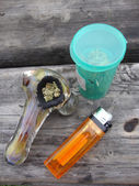 Jar of Medical Marajuana, Pipe and lighter sitting on a well use — Stock Photo