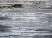Worns and tattered wood siding — Stock Photo