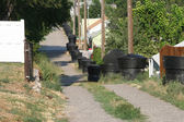 Dumpsters down a city alleyway — Stock Photo