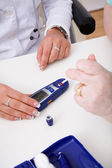 Young doctor check the blood-sugar level — Stock Photo