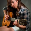 Teen girl playing guitar — Stock Photo #3558084