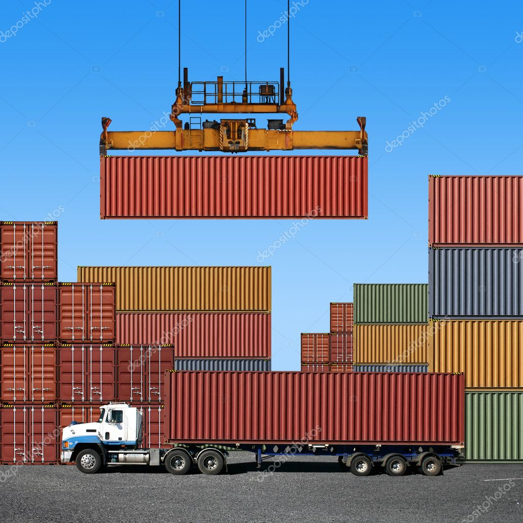 Stack of freight containers at the docks with Truck  Foto de Stock   #2943943