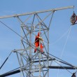 Stock Photo: Worker on top of hydro tower