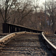 Stock Photo: Railroad tracks over bridge