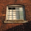 Old factory window on a brick wall - Stock Photo