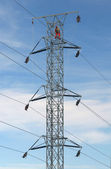 Worker on top of a hydro tower — Stock Photo