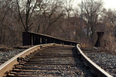 Railroad tracks over a bridge — Stock Photo