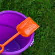 Purple Pail With Orange Shovel — Stock Photo #3008016