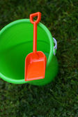 Green Pail With Orange Shovel — Stock Photo