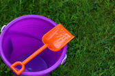 Purple Pail With Orange Shovel — Stock Photo
