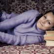 Stock Photo: Cute girl with books