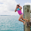 Leap off wharf - Stock Photo