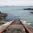 Train track into the ocean — Stock Photo