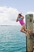Leap off wharf — Stock Photo