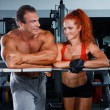 Woman and man in a health club — Stock Photo
