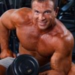 Bodybuilding in fitness club — Stock Photo