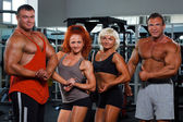 Women and men in a health club — Stock Photo