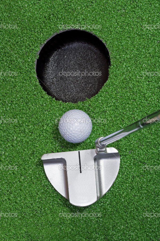 A putter hits a golf ball into the hole. — Stock Photo #2744051