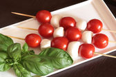 Tomatoes and mozzarella on skewers — Stock Photo