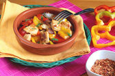 Chicken with red and yellow peppers — Stock Photo